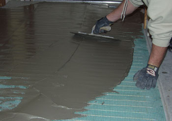 Installation Of A Floor Heating Roll